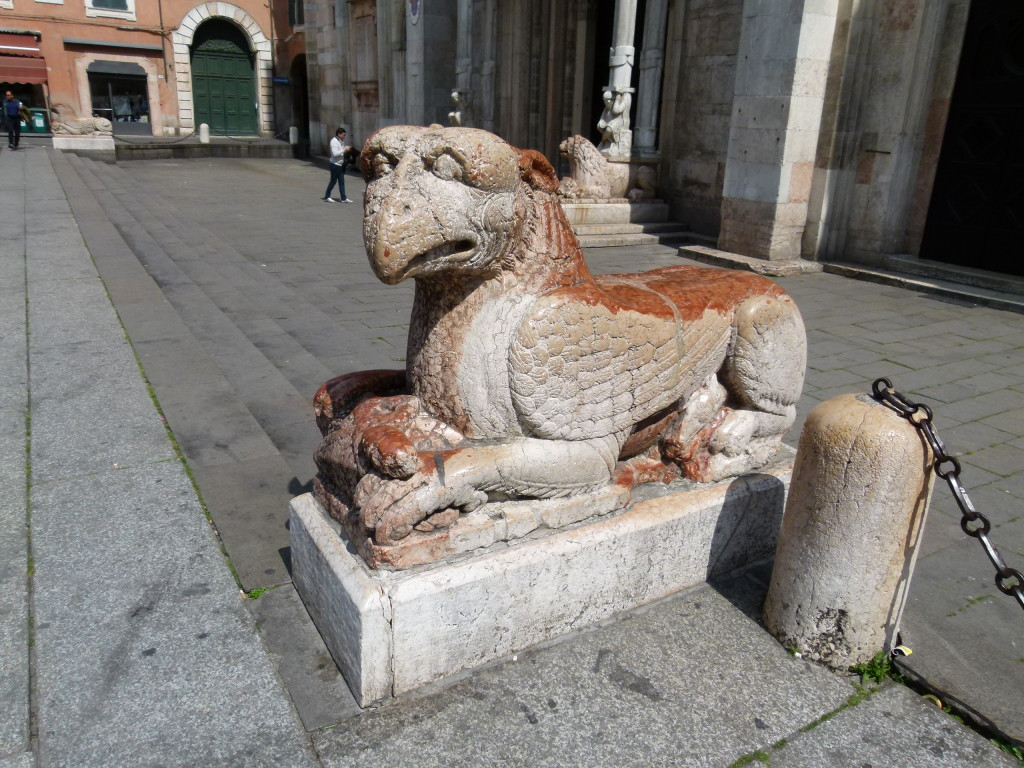 We saw a few of these creatures in front of several churches. What are they??