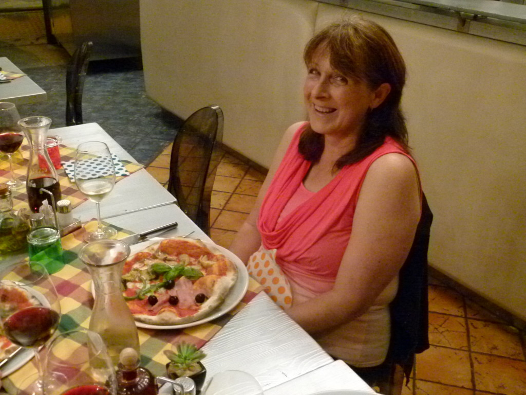 Lori with her pizza. She was afraid that she would be able to eat it all. She was wrong we even had desert afterwards.