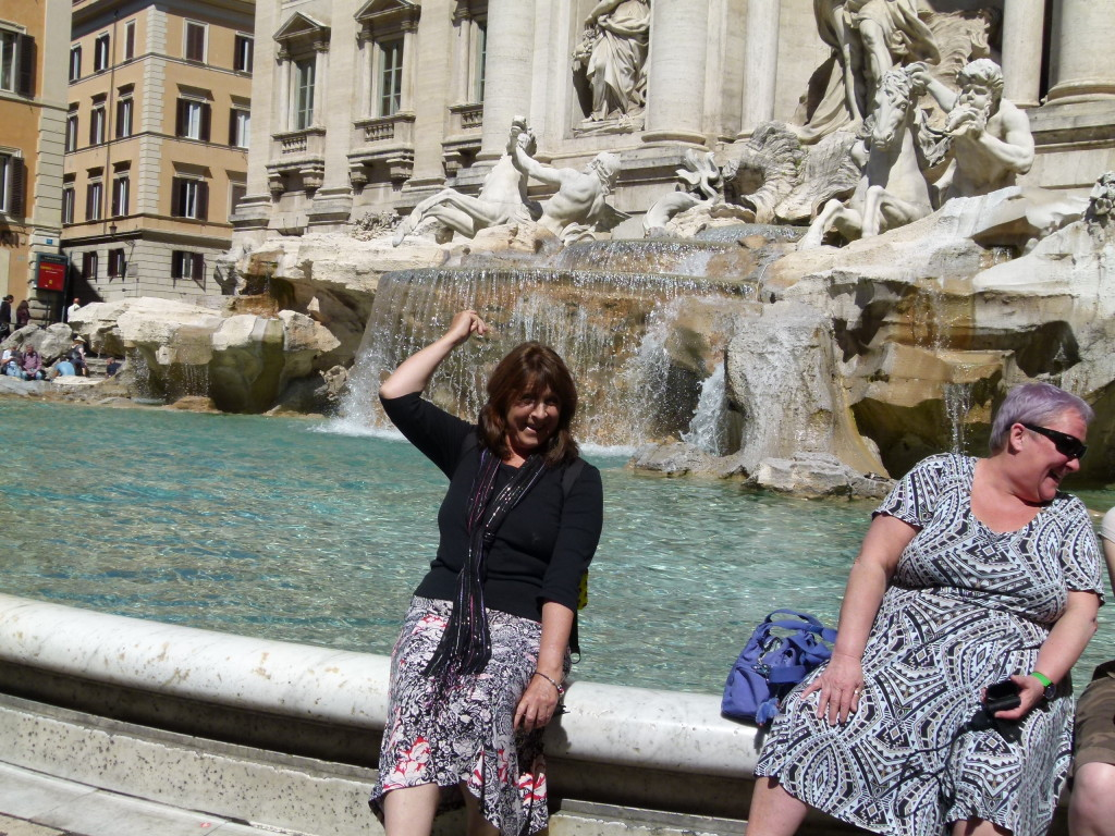 Lori tossing a coin into the fountain.