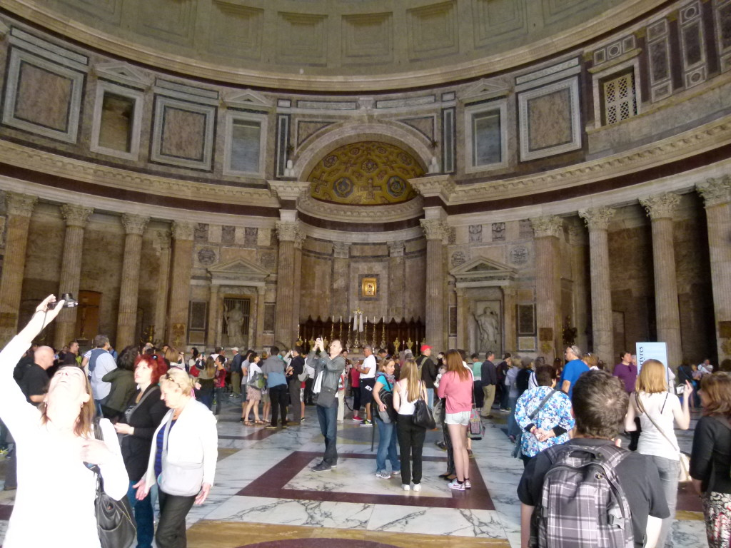 Inside of the Pantheon. Very busy and hectic with people and we are here in the off season.