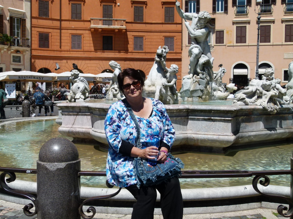 Jenny on a fountain in the Piazza Novona.