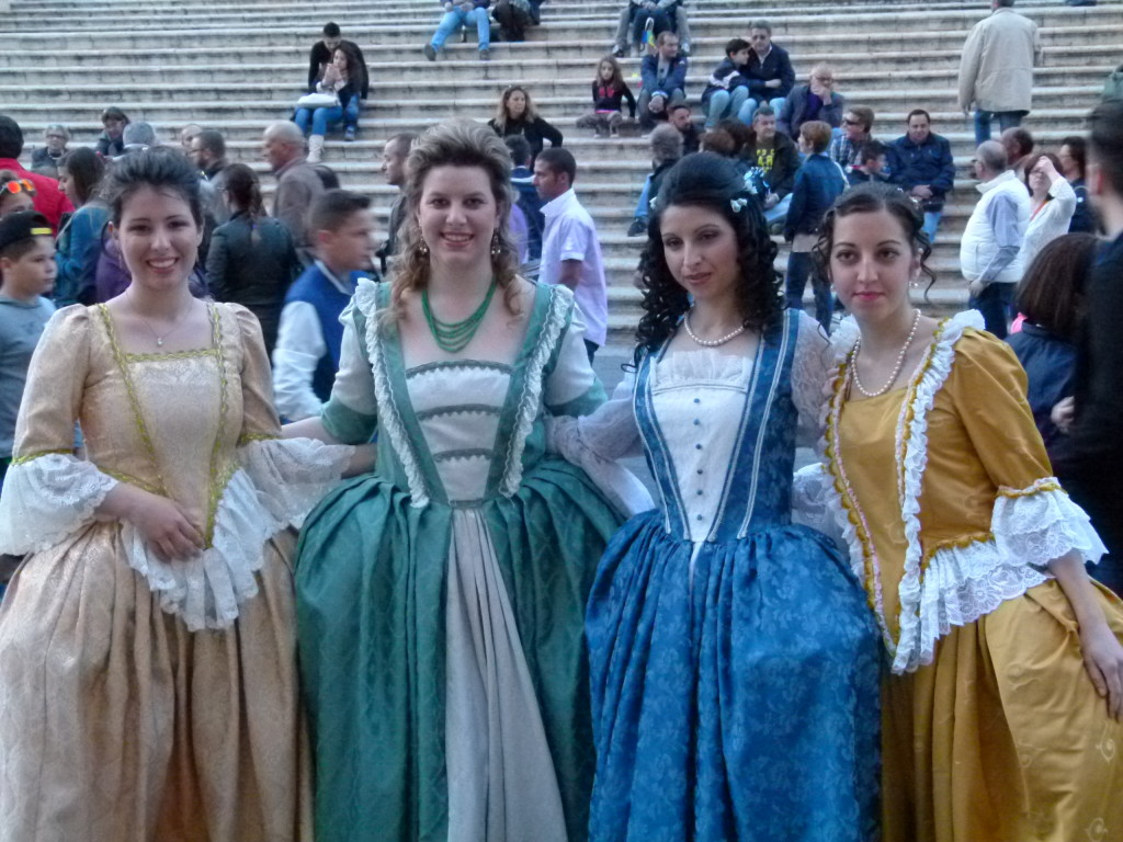 Ladies posing in their costumes.