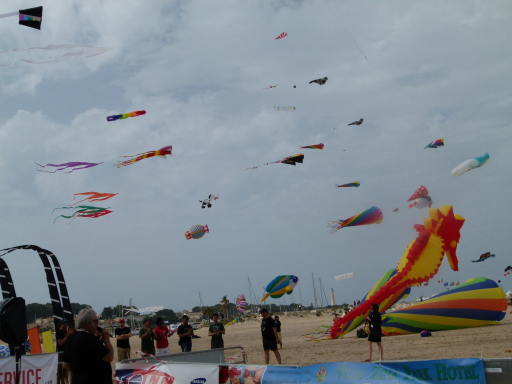 The sky full of colour as the kites fill the beach site.