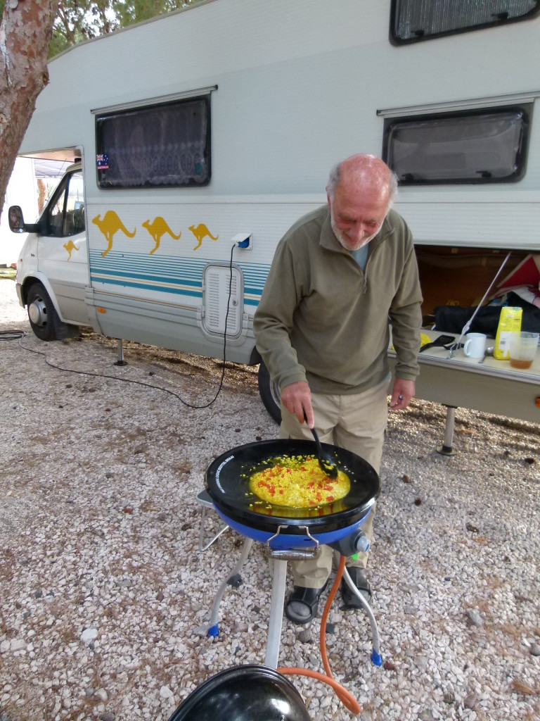 Clyde the master chef cooking paella for our evening meal. Very delicious.