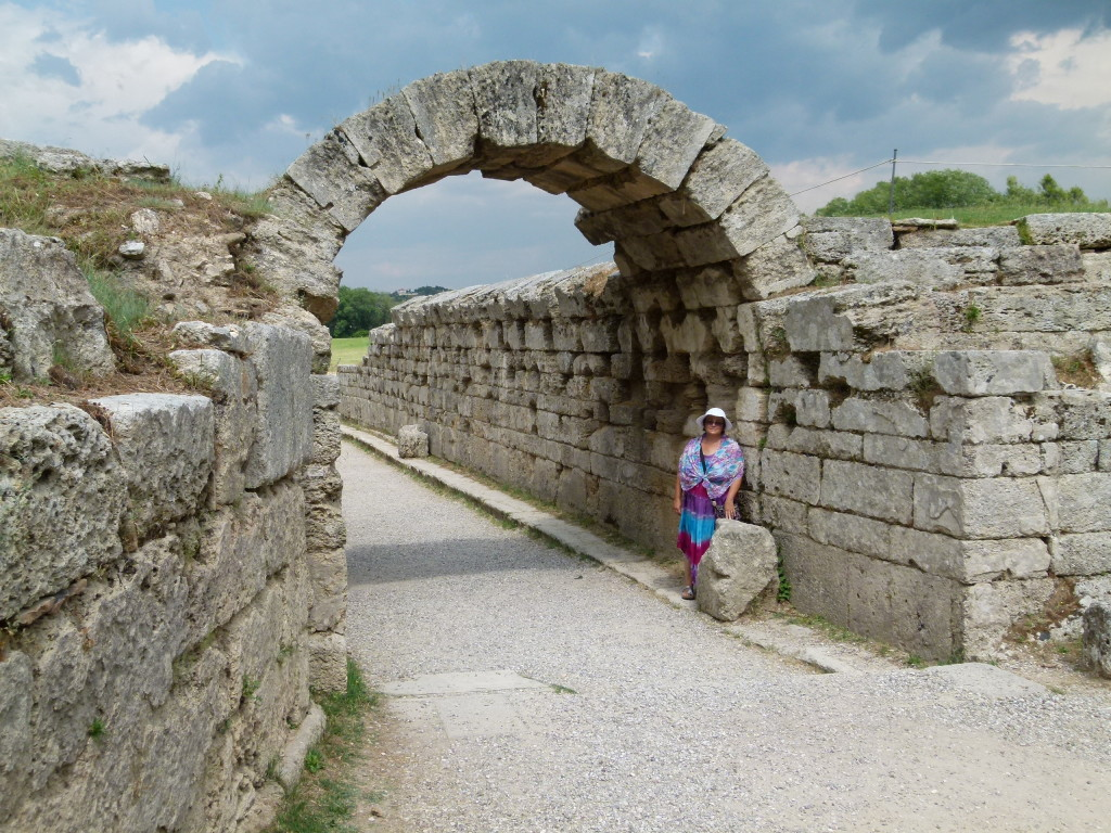 Jenny at the archway to the track where the ancient Olympics were held.