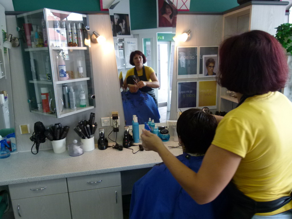 Jenny having a haircut. She did a good job despite our language barrier.