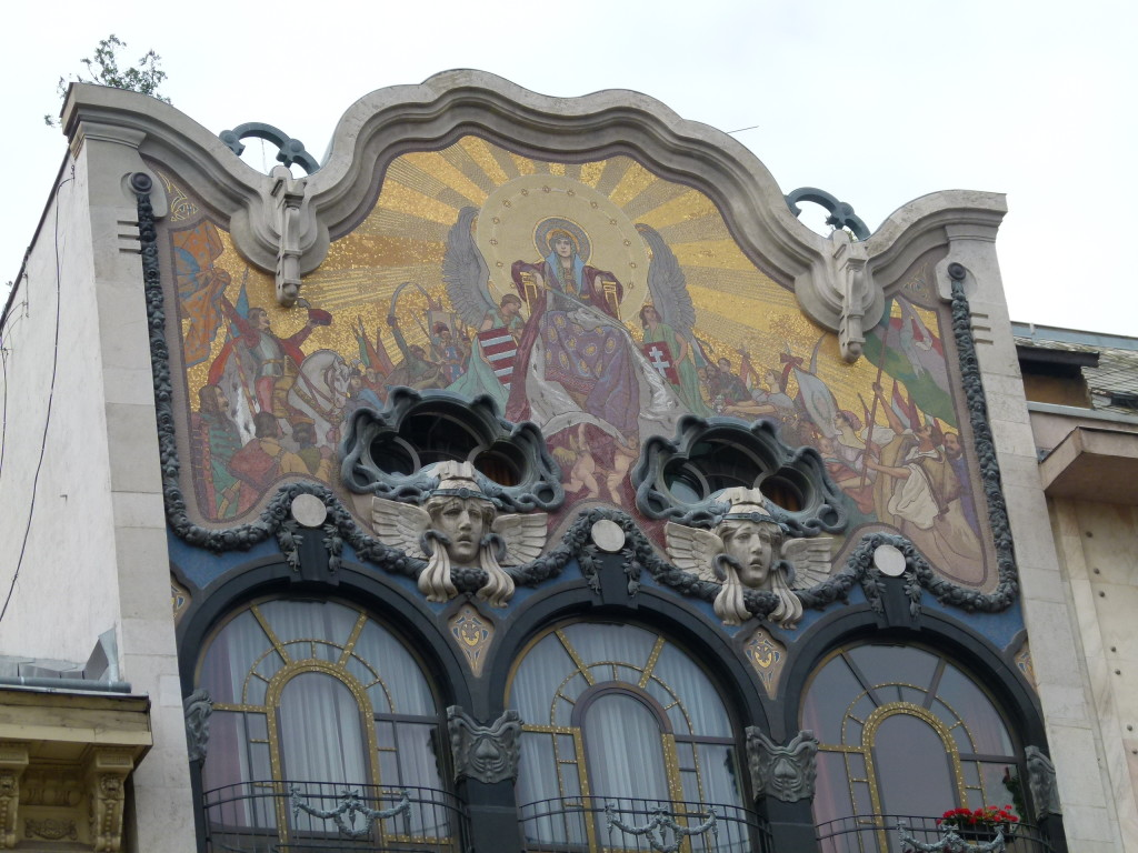 Art nouveau decoration on the top story of a Budapest building