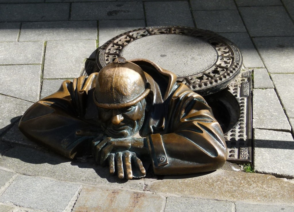 This is the statue of Cumil a worker coming up from the manhole in the street. He has become a landmark of Bratislava.
