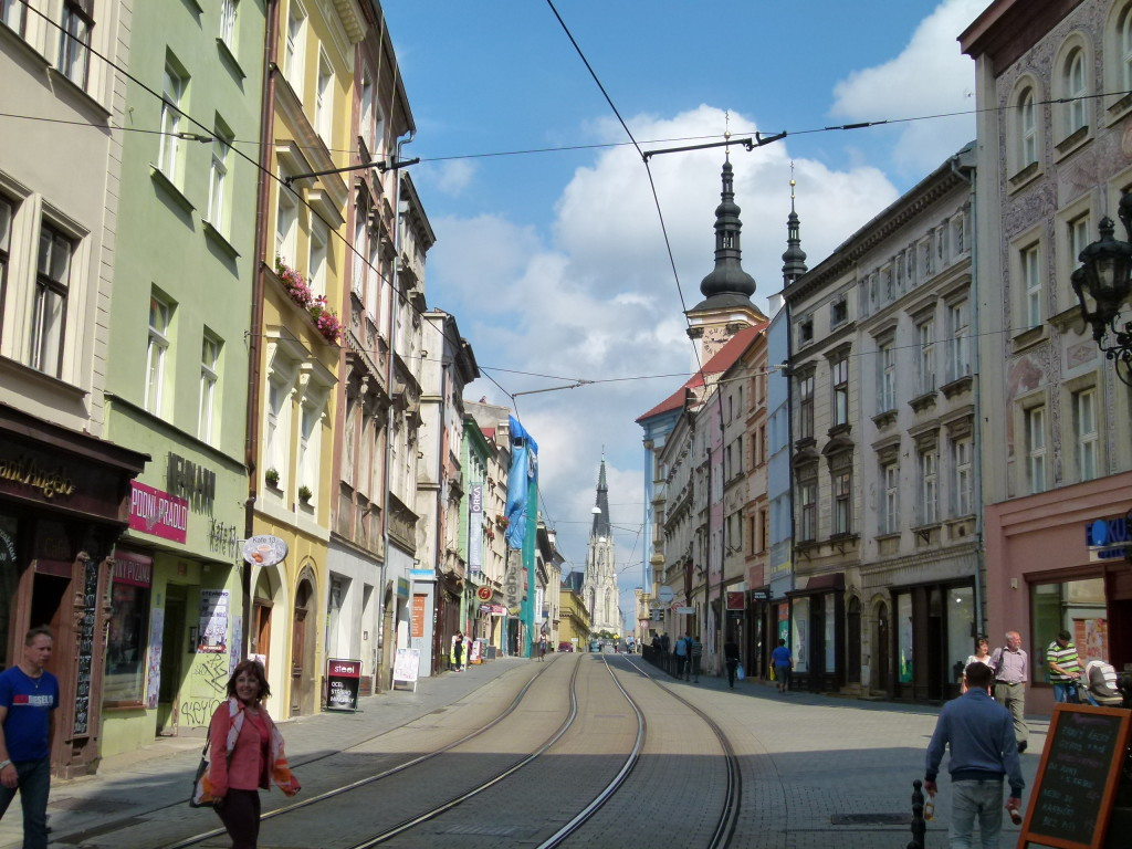 Streetscape of Olomouc, with tram lines running down the road.