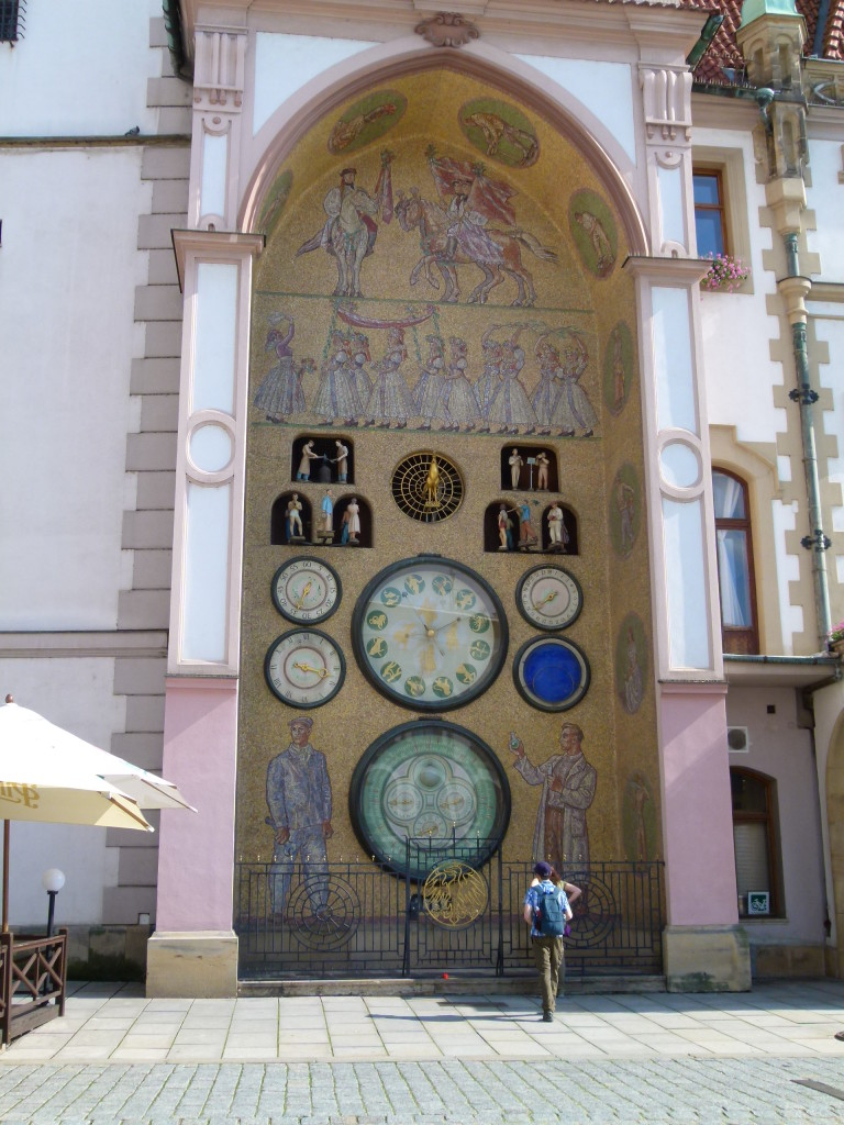 Astrological clock on the outside of the town hall. The present-day appearance of the Clock dates back to the 50s of the 20th Century and bears the traces of the former official aesthetic of socialist realism.