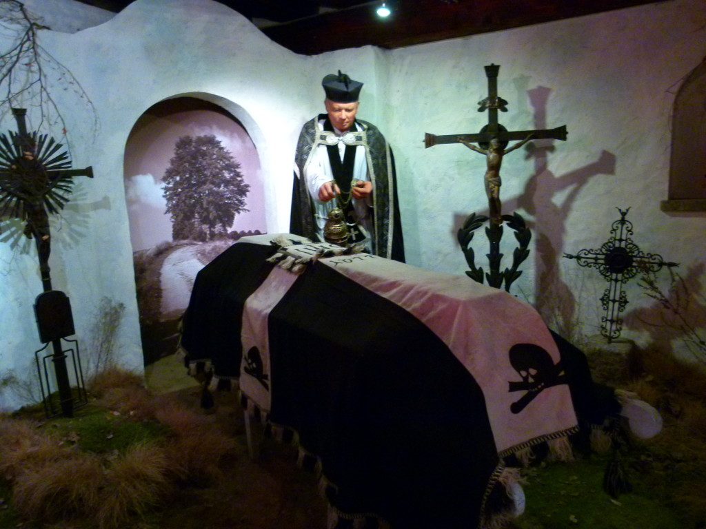 Another display depicting a funeral.