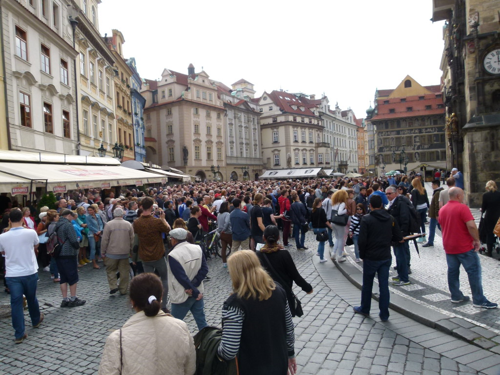 The crowds waiting for the Astronomical clock to signal the hour