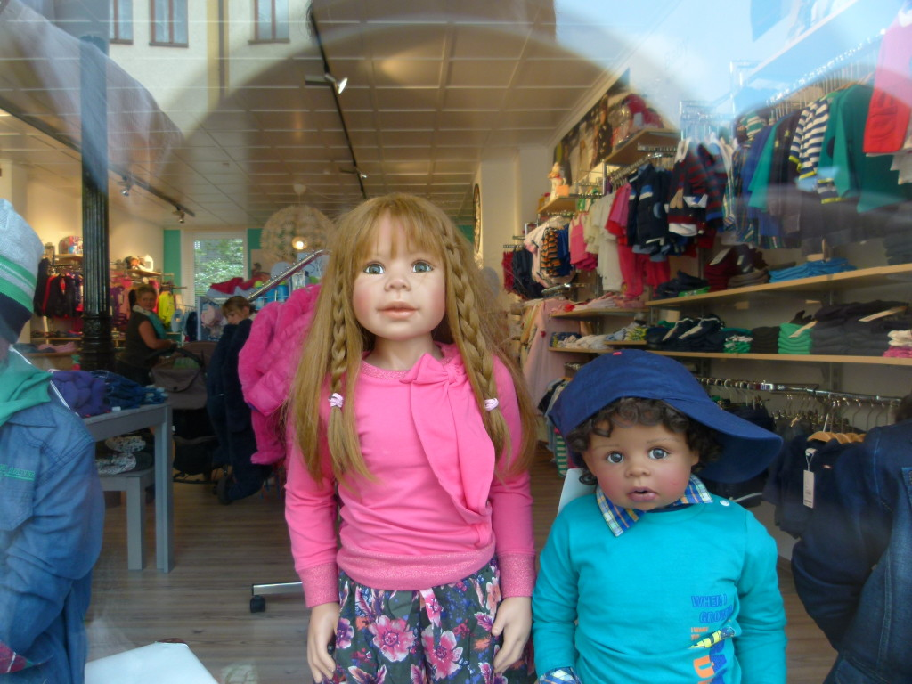 life like mannequins in a clothes shop window. We think the girl looks very much like one of our granddaughters.