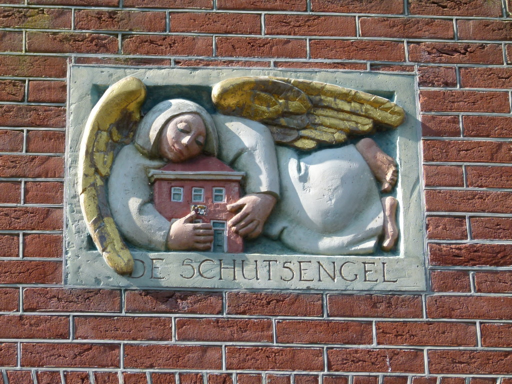 On many of the houses and businesses they had wall plaques.