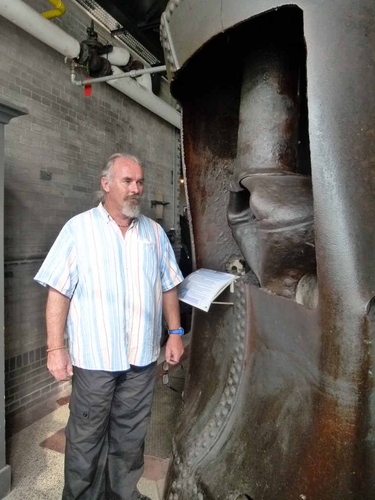 Ewout standing next to boiler that exploded in 1924 in Amsterdam. It traveled 300 meters and was buried 3 meters in the ground when it landed.