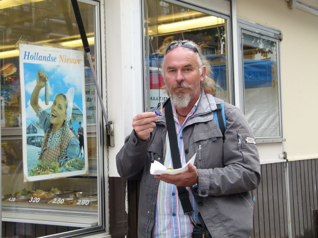 Ewout with his Hollands Niew,( Fresh uncooked herring with onions and pickles