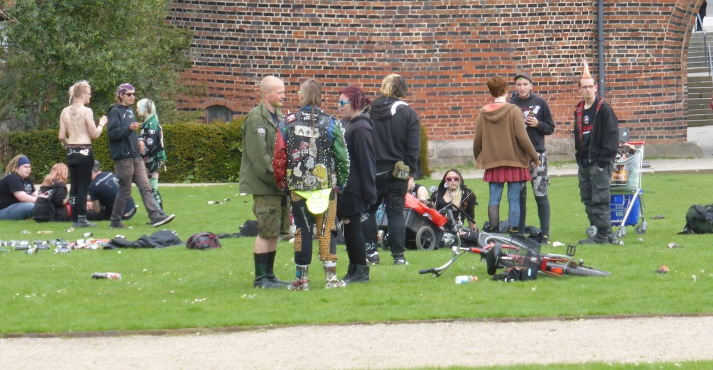 Punks in the park in front of the town gates.