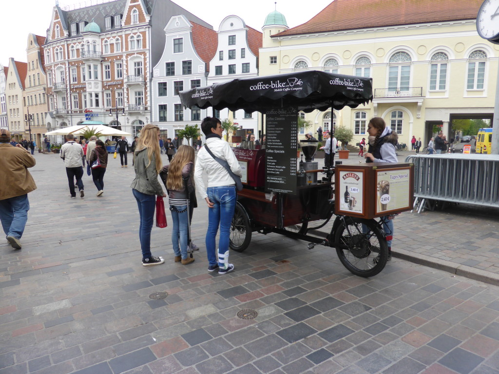 A mobile coffee vender in the main square.