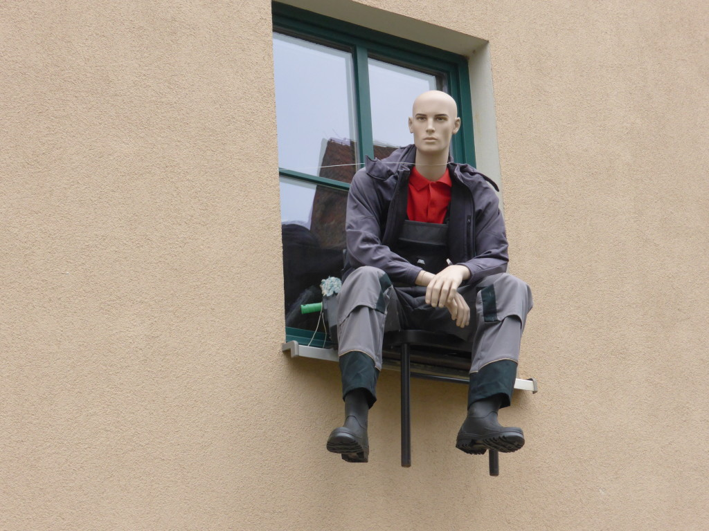 A we were walking back we saw a man sitting on the window ledge, on closer inspection he was a dummy.