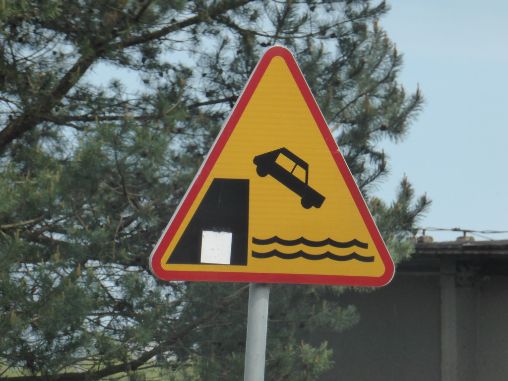 Sign at the ferry crossing. A gentle reminder not to drive of the edge and into the water.