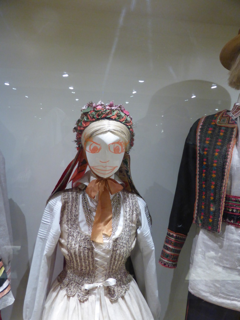 See the eyes and the mouth! They have been drawn on the glass display case and not on her. See photo below.
