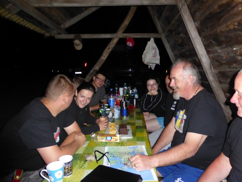 Ewout with his new T-shirt sharing the evening with the Polish people at the campsite.