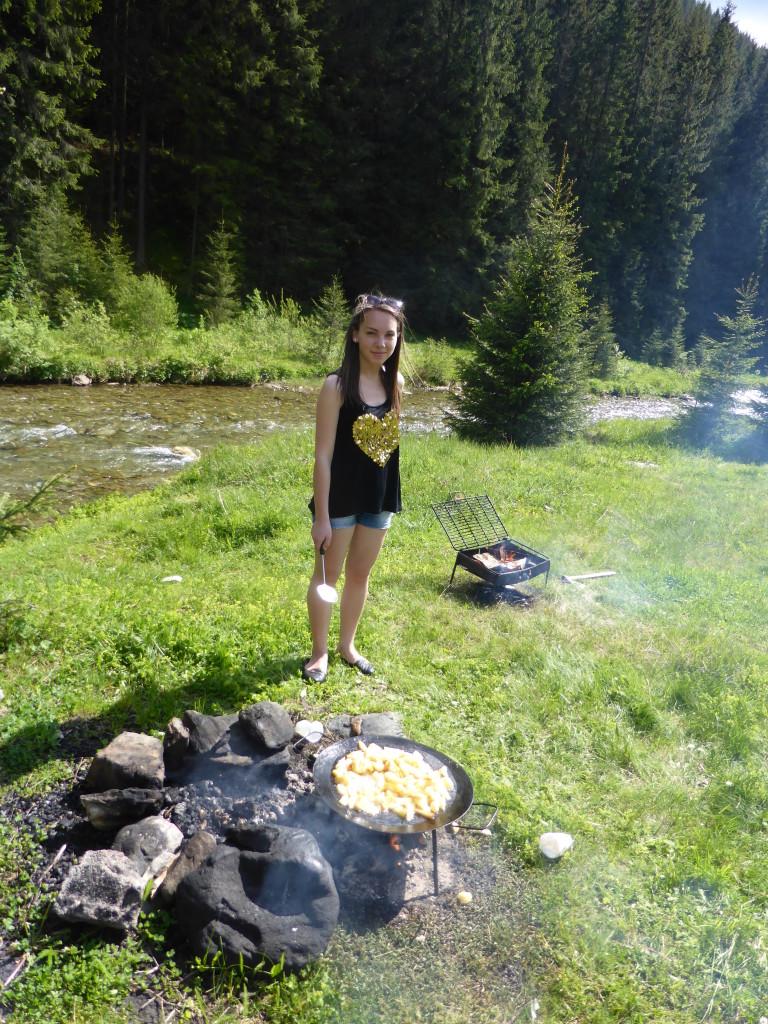 Cooking dinner over an open fire.