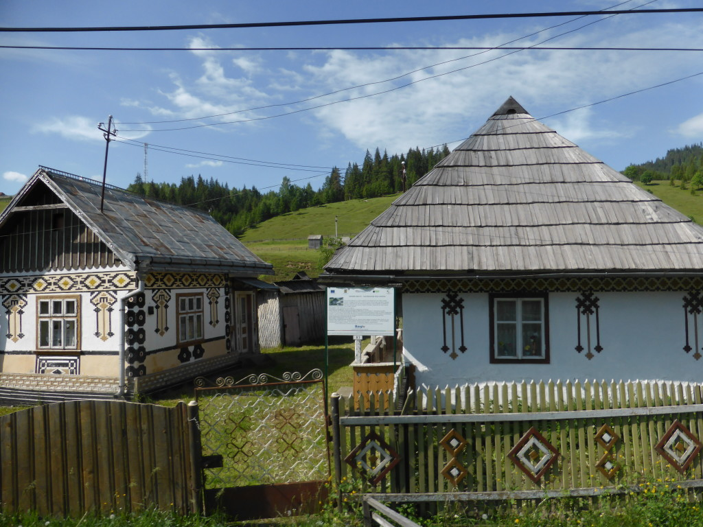 Although the road was rather bad the scenery was great. Here are a couple of houses that have been decorated.
