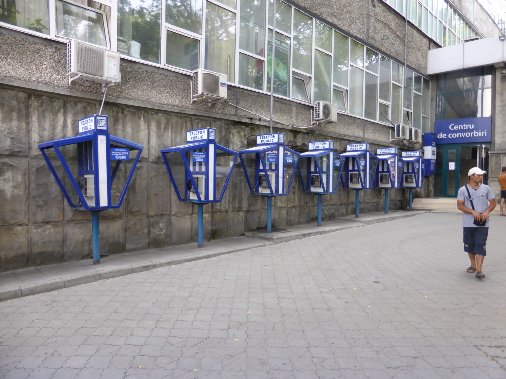 This is something that I haven't see for awhile public telephone boxes all in a row.