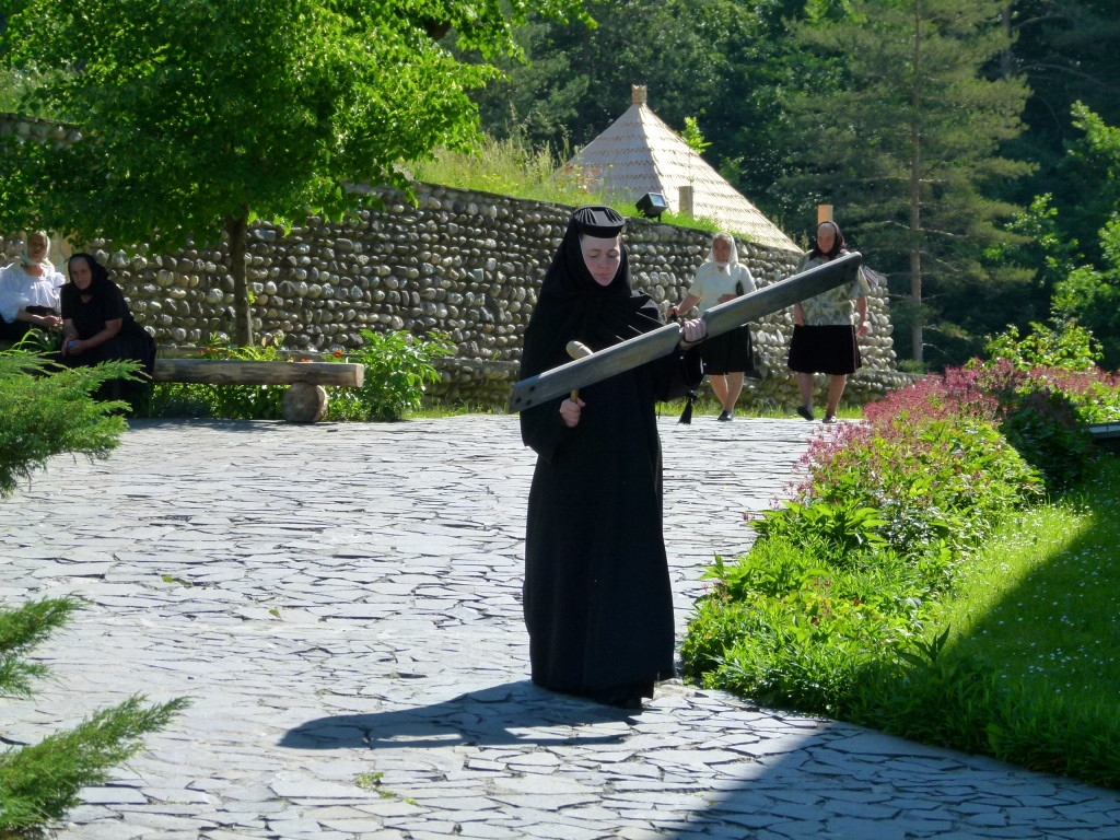 Not sure what was happening, this nun walked around banging a piece of wood with a mallet.