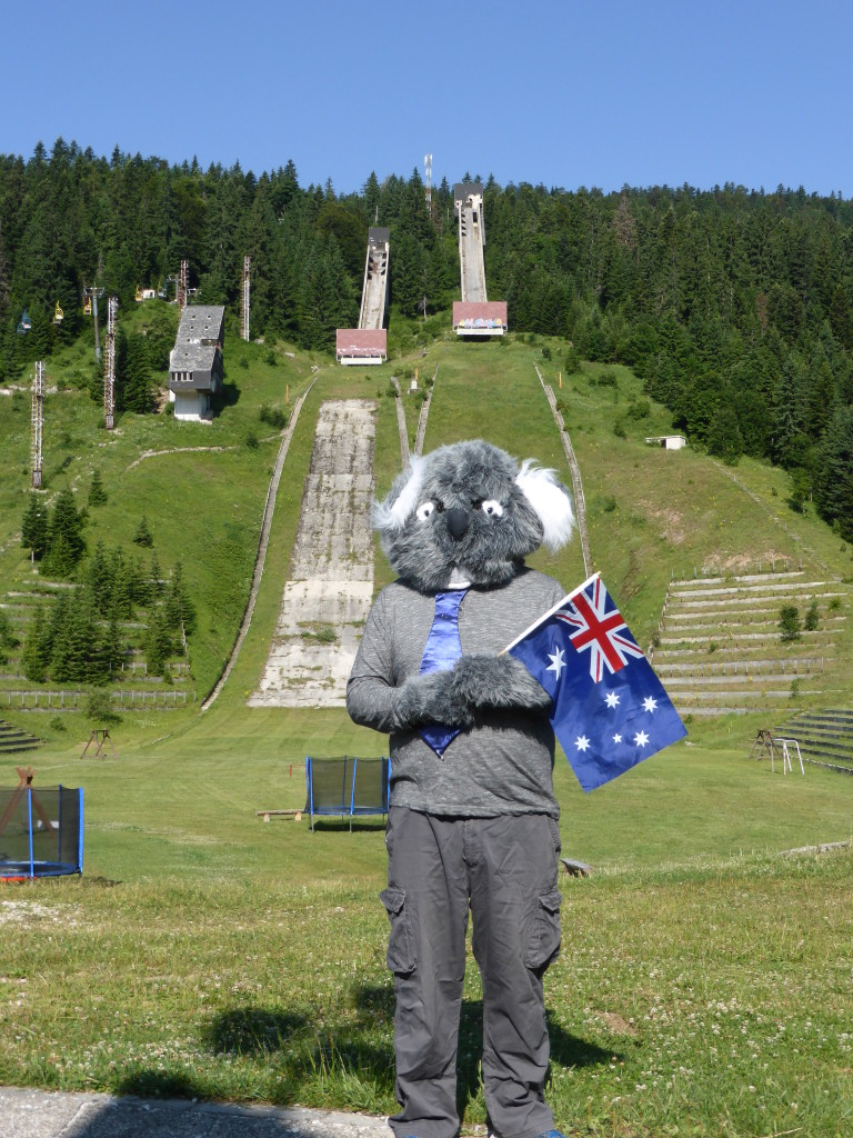 The Koala standing in front of the ski ramps.