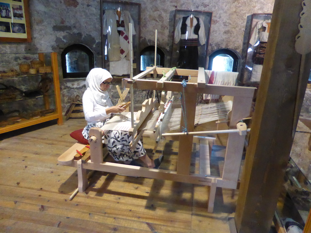 In the large circular tower This lady was busy weaving amongst examples of traditional work.