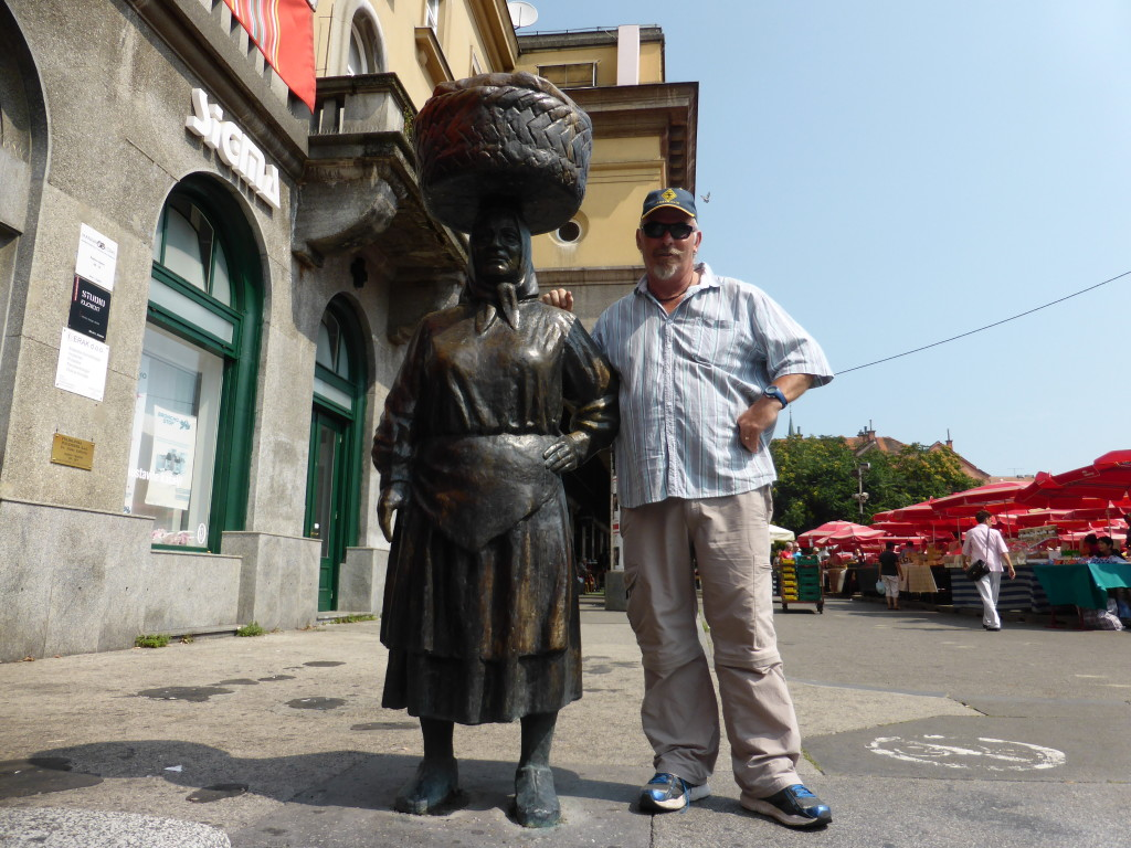 Ewout with the market lady.This statue is at the entrance to the market which still exists.