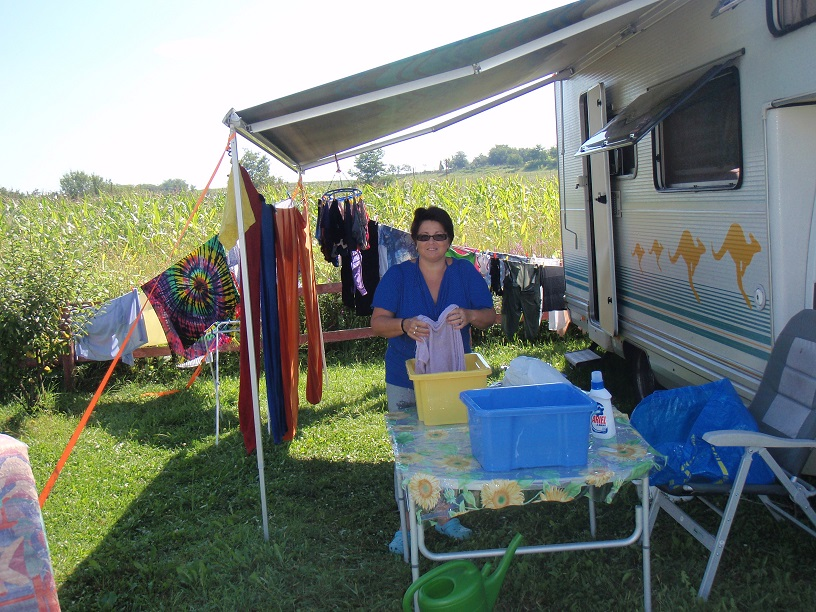 Giving the clothes the final rinse. We did have a glass of wine and a relaxing afternoon when we finished. You cant work all the time!!!