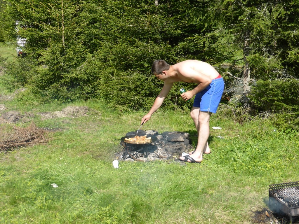 Cooking over a fire in the outdoors.